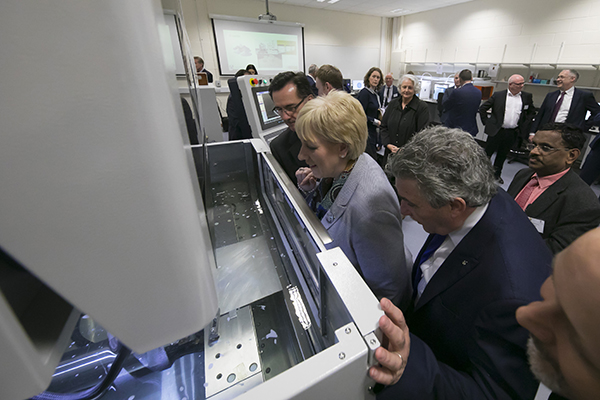 Minister for Business, Enterprise and Innovation, Heather Humphreys, and Minister of State for Training, Skills, Innovation, Research and Development, John Halligan, viewing WIRE EDM-3D printing post processing equipment